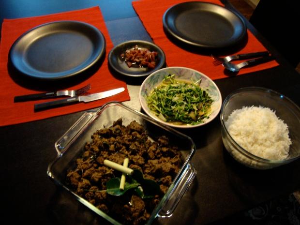 Enjoying beef rendang with rice